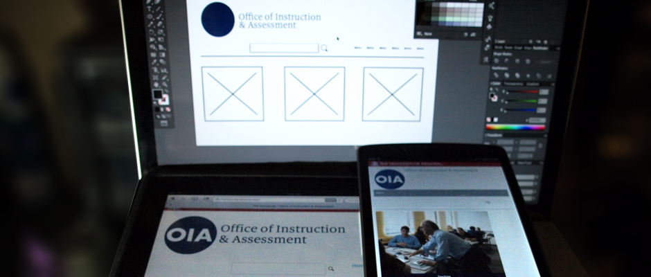 A photo of OIA website being developed and displayed on multiple devices